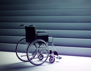 image of an empty wheel chair facing a set of large stairs
